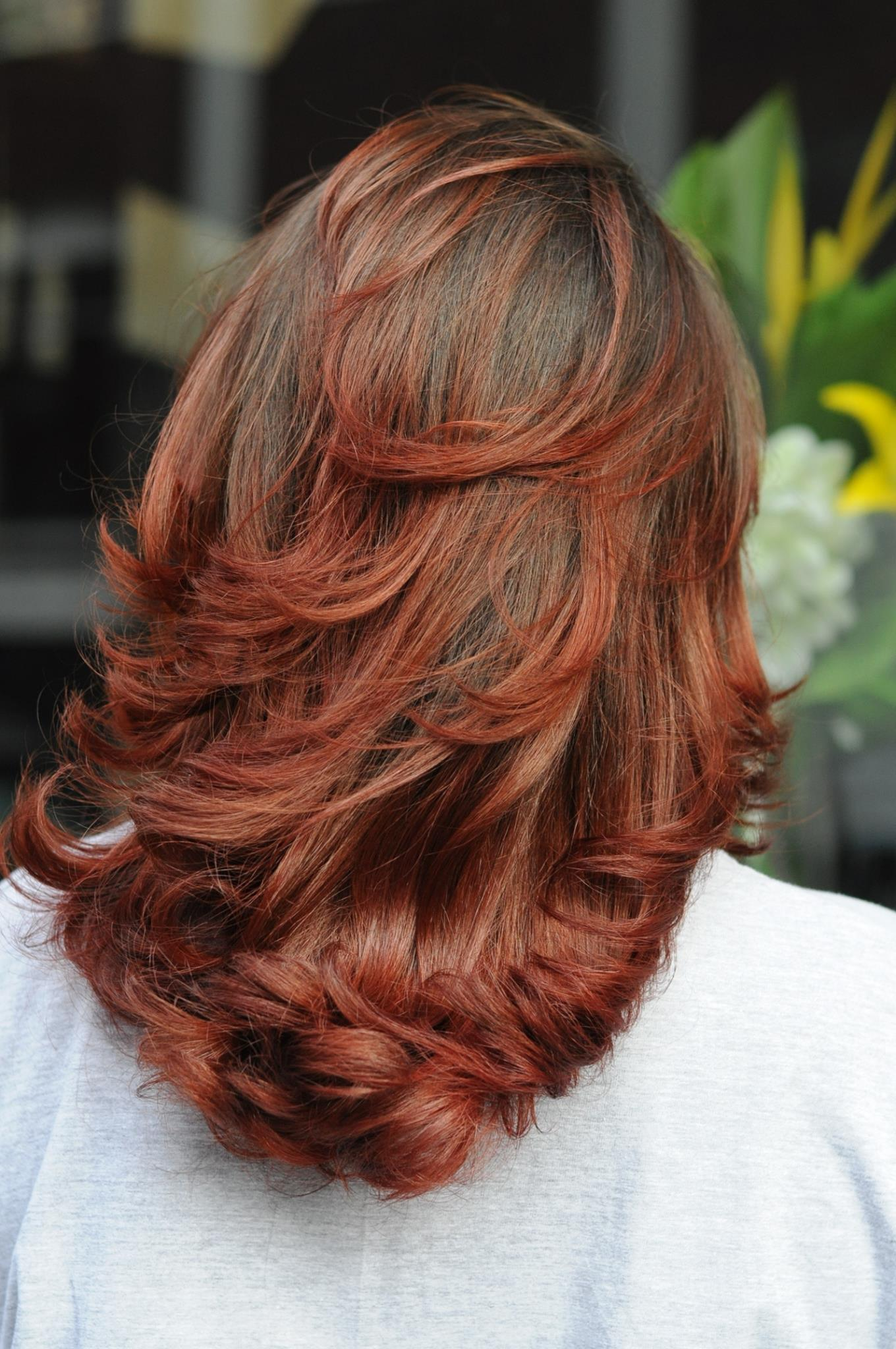 The client's very first hair colour. Natural dark brown fired up a little with beautiful dark red balayage