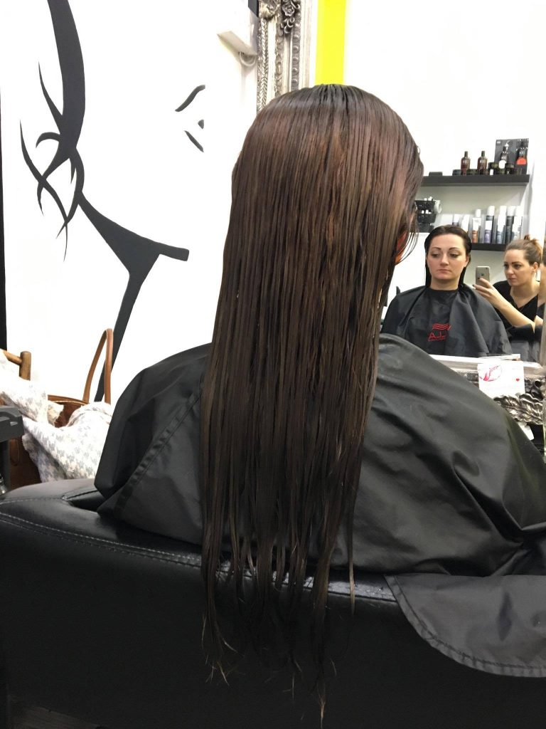 After the application and set time of the final hair colour, before the finishing blow dry