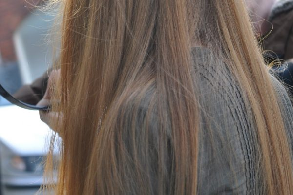 Checking hair colour outside in natural light