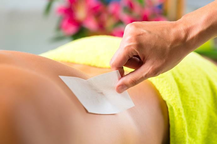 man_spa_getting_waxed_med