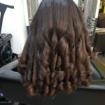 Curly hair after a professional blow dry