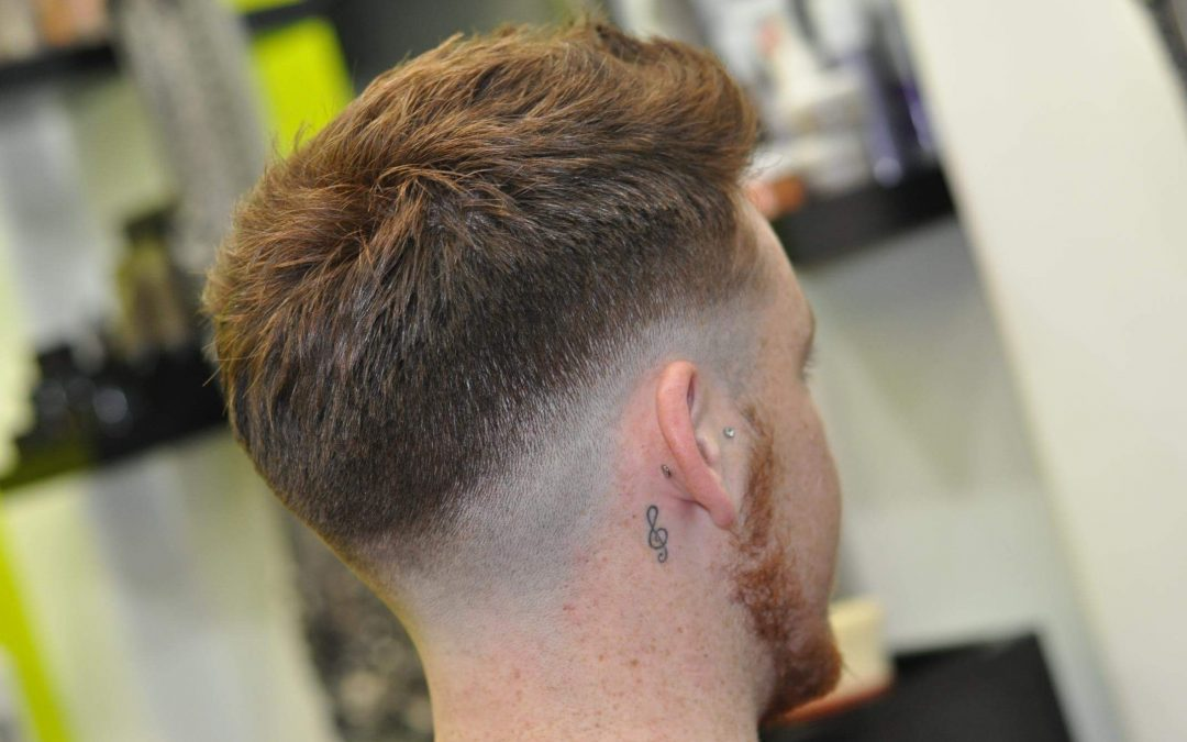 The mid skin fade – a masculine, sporty hairstyle for gents