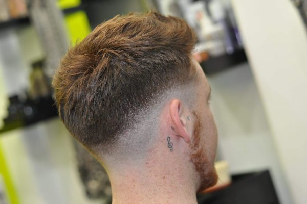 Mid-skin drop fade haircut