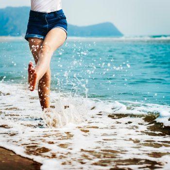 Barefoot beach legs